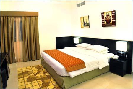 غرفة فندق وأجنحة رمادا عجمان