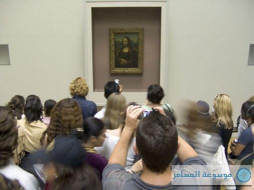 cn_image.size.tourists-mona-lisa-cameras